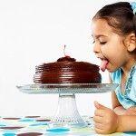 Kid licking a cake