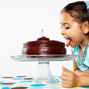 Kid licking a cake