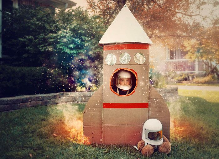 Boy in a cardboard rocket